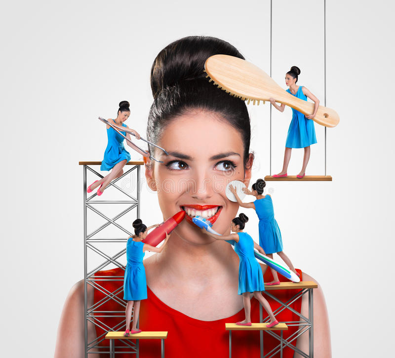 Workers working on a beautiful woman stock images