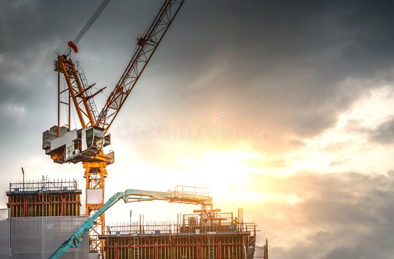 Workers are working on a large building construction industry site. royalty free stock images