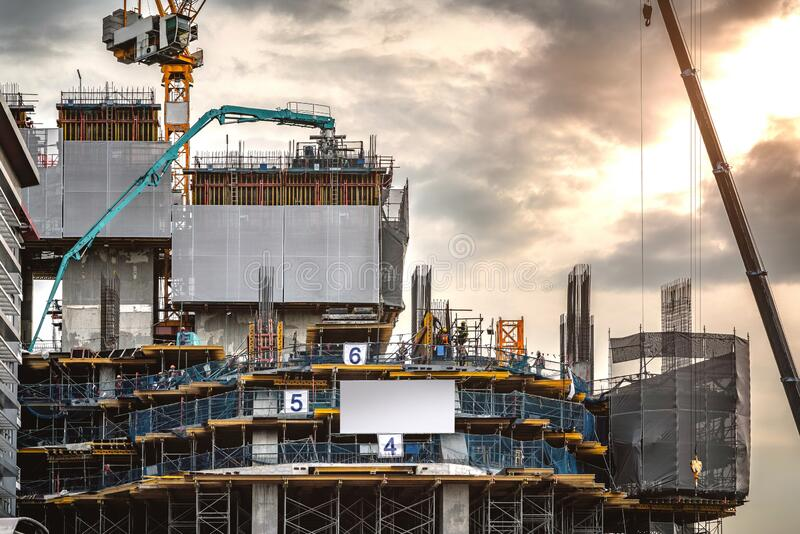 Workers are working on a large building construction industry site. royalty free stock image