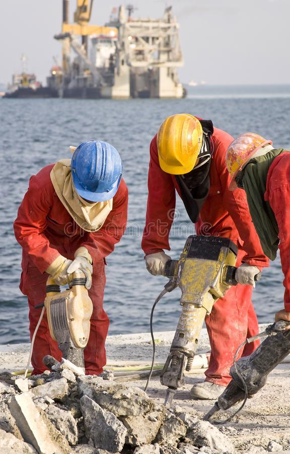 Workers are working in port construction. stock photography