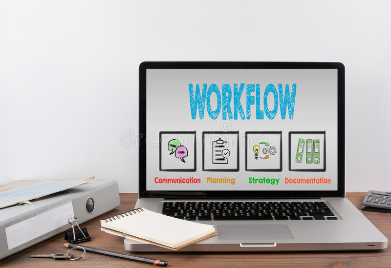 Workflow concept. Office desk with a laptop. Workflow concept. Wooden office desk with a laptop stock images