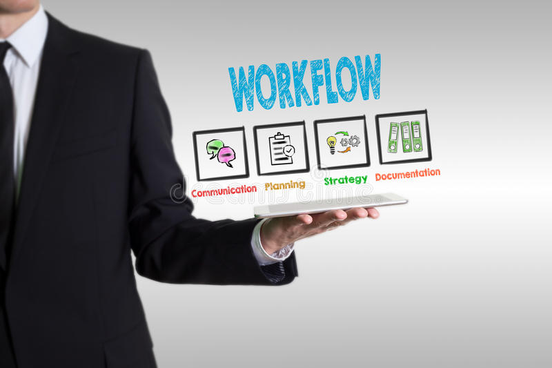 Workflow concept, young man holding a tablet computer stock photography