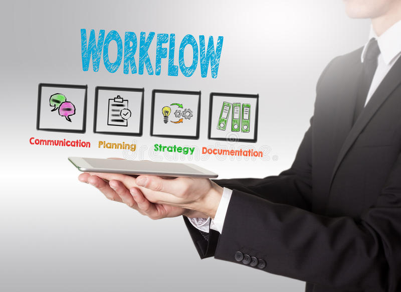 Workflow concept, young man holding a tablet computer royalty free stock images
