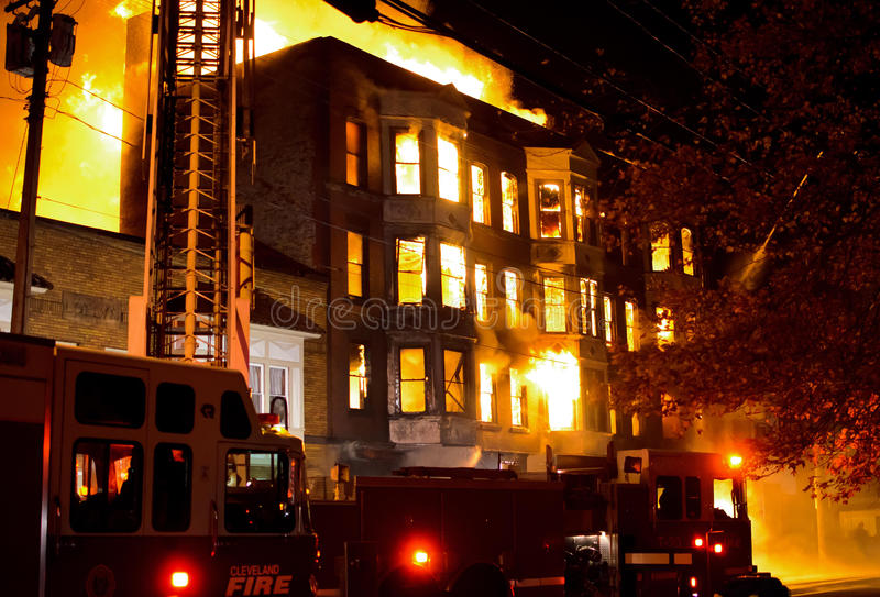 Burning building. Total loss of an apartment building stock images