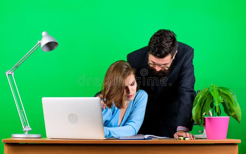 Working as one team. secretary with boss at workplace. business couple at computer. businessman and assistant has royalty free stock photos