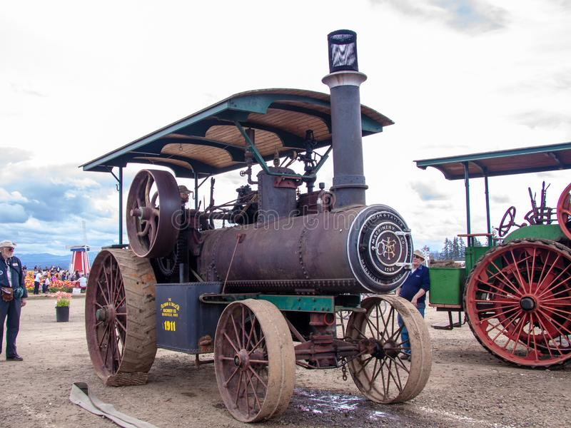 Working Aultman-Taylor Engine steam tractor at Wooden Shoe tulip farm. During Tulip Festival , Woodburn, Oregon royalty free stock photo