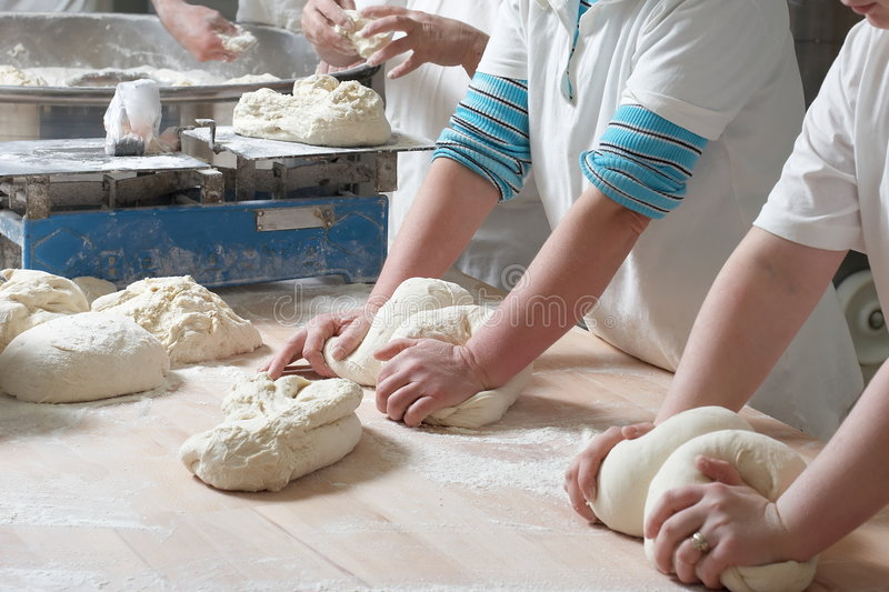Working bakery team royalty free stock image