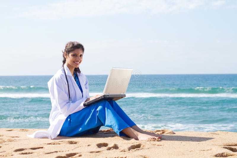Working on beach royalty free stock photography