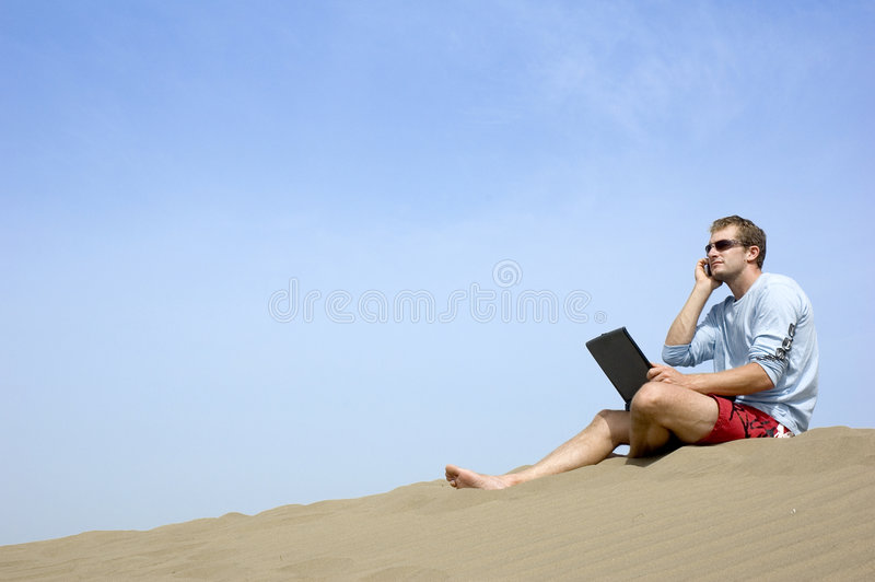 Download Working On The Beach3 Stock Image - Image: 1364971
