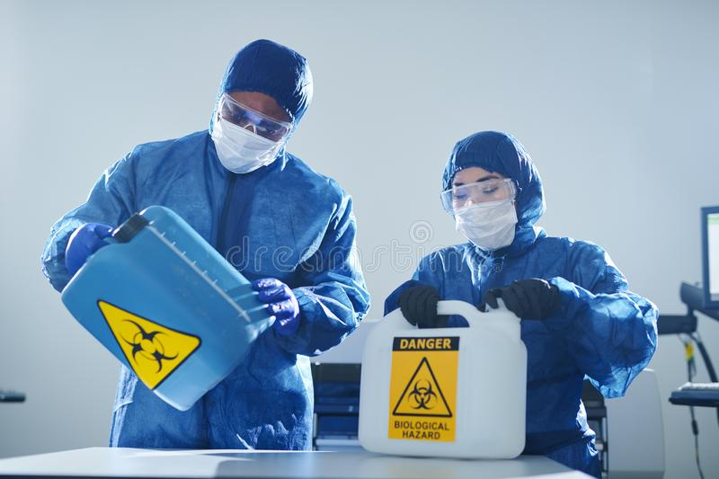 Working with biohazards stock photography