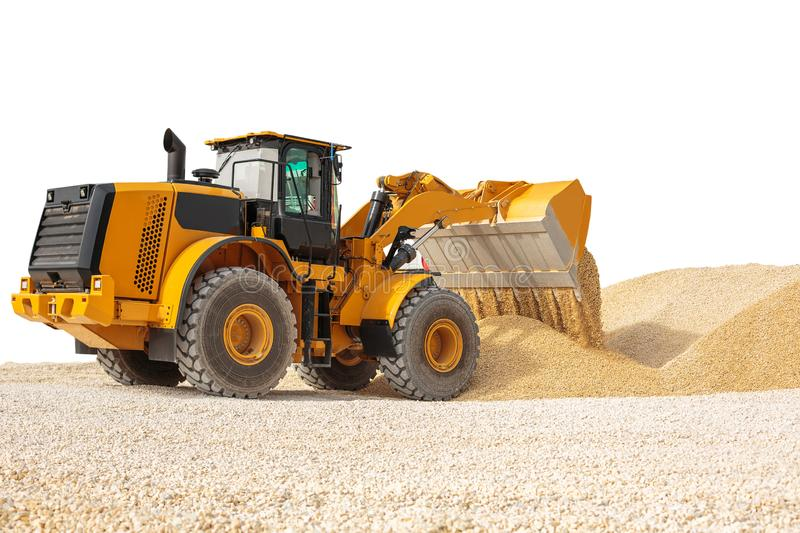 Working bulldozer on a building site isolated with clipping path. Modern wheel loader stock photography