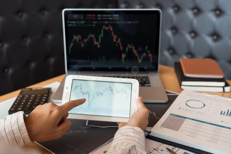 Working business man of broker or traders thinking about forex on multiple computer screens of stock market invest trading. Financial graph charts data analysis royalty free stock images