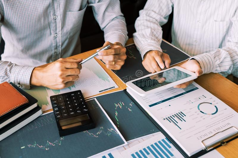 Working business man, team of broker or traders talking about forex on multiple computer screens of stock market invest trading. Financial graph charts data stock photography