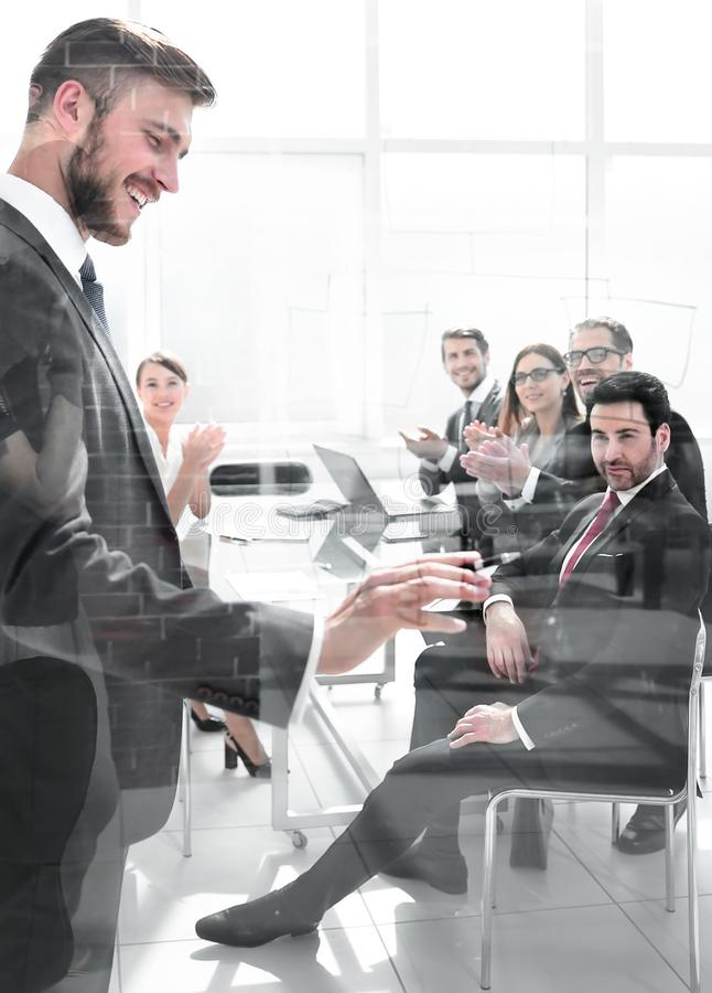 Working business people behind glass walls royalty free stock images