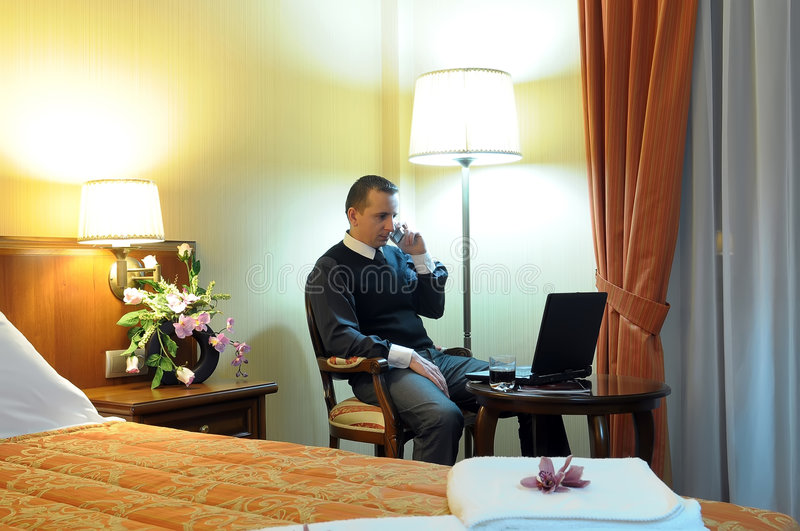 Download Working Businessman In A Hotel Room Stock Image - Image: 8469223