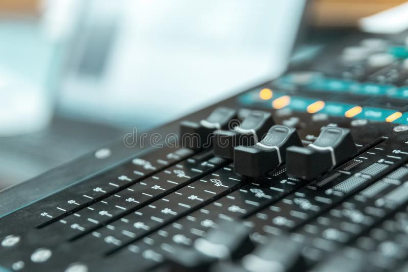 Working buttons of the mixing console digital console close-up stock image