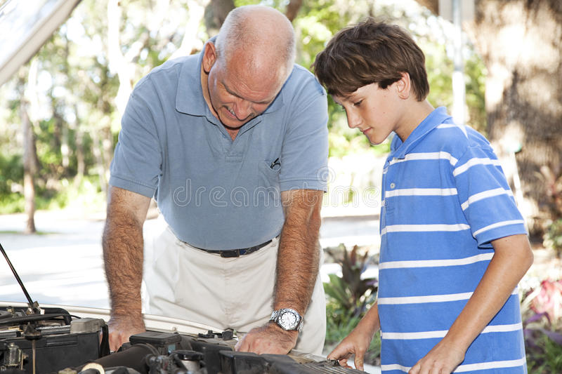 Working on Car Engine Together royalty free stock photo