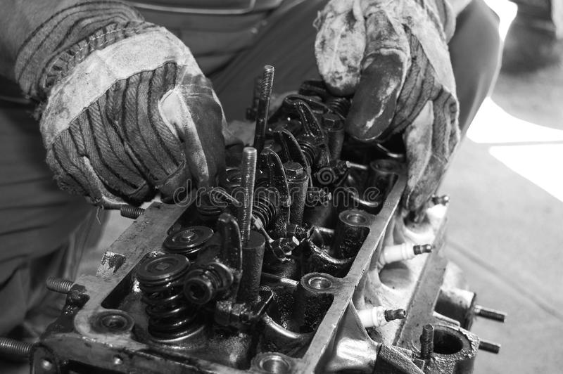 Working on a car motor stock images