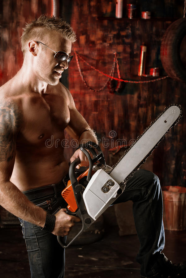Working with chainsaw stock photography