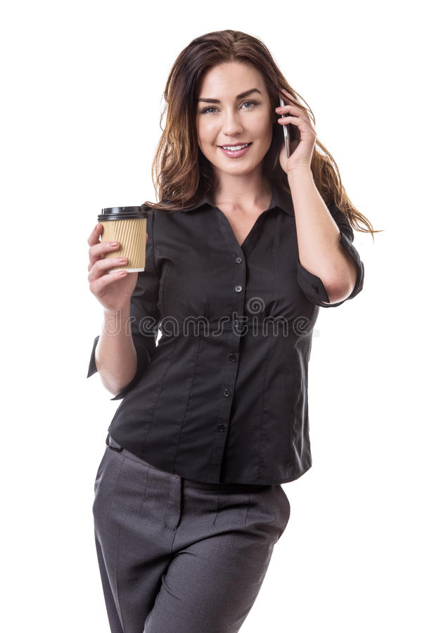 Working coffee break. Pretty business model with a mobile phone and a takeaway coffee cup stock photography