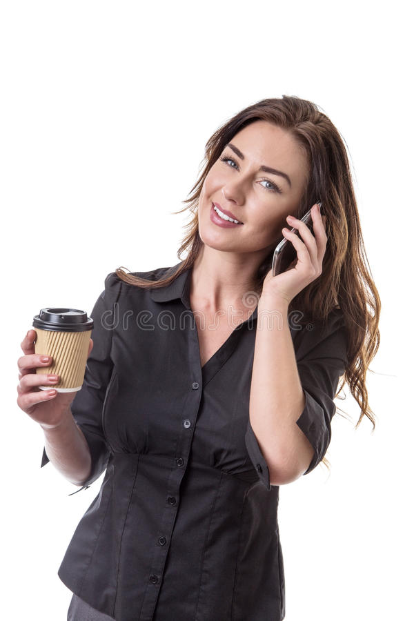 Working coffee break. Pretty business model with a mobile phone and a takeaway coffee cup royalty free stock images