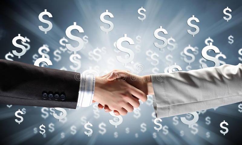 Working in collaboration. Close up of business handshake on digital background stock photography