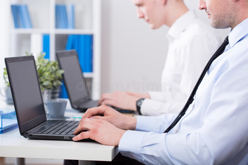 Working on computers stock images