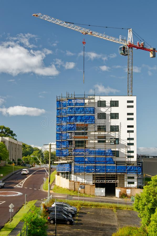 Working construction crane. Update 189. Gosford. February 2019. Gosford, New South Wales, Australia - February 23, 2019:  A working tower crane on new home units royalty free stock image