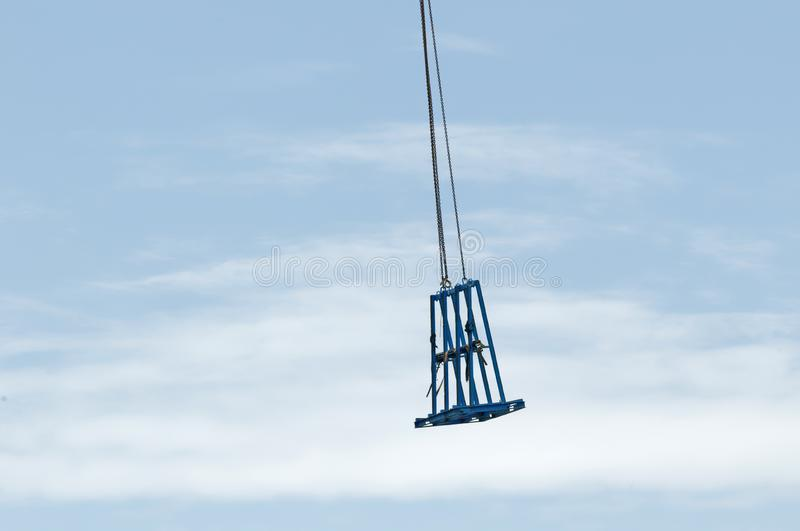 Working construction crane. Update 171. Gosford. January 2019. Gosford, New South Wales, Australia - January 31, 2019: Tower Crane unloading a cradle from new stock images