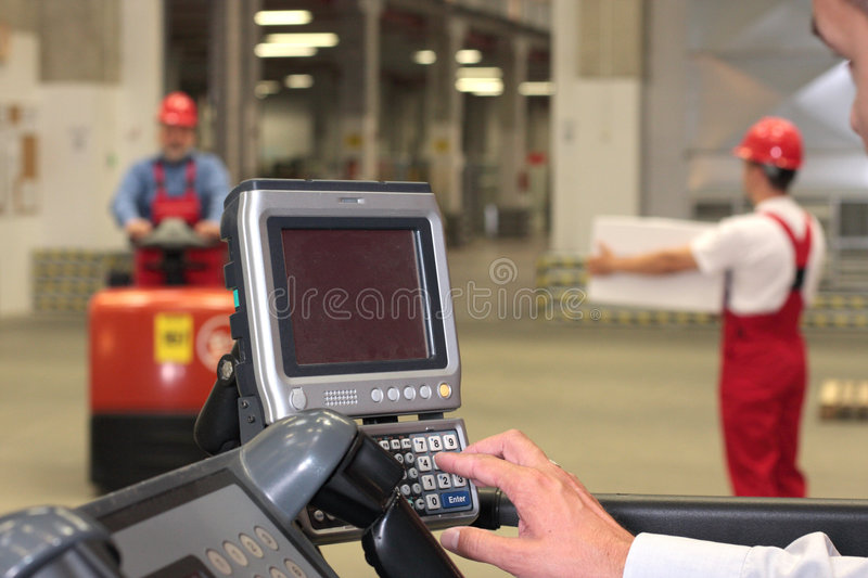 working with control panel in warehouse - close stock photo