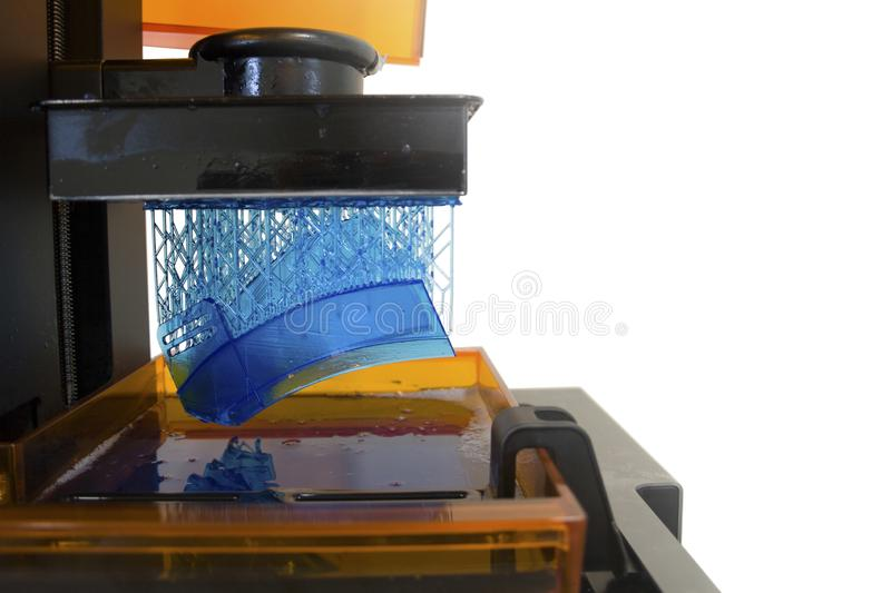 Working 3D printer. Electronic three dimensional printing machine in process. Automation technology. Automatic performing product detail creation. Close-up stock image