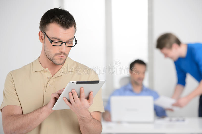Working On The Digital Tablet. Confident Young Businessman Holdi Stock Images
