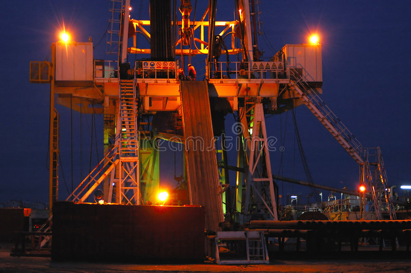 Working drilling rig in night royalty free stock image