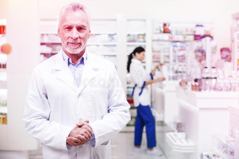 Professional wise pharmacists working in a drugstore stock photography