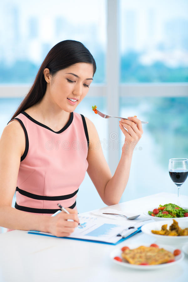 Working and eating stock image