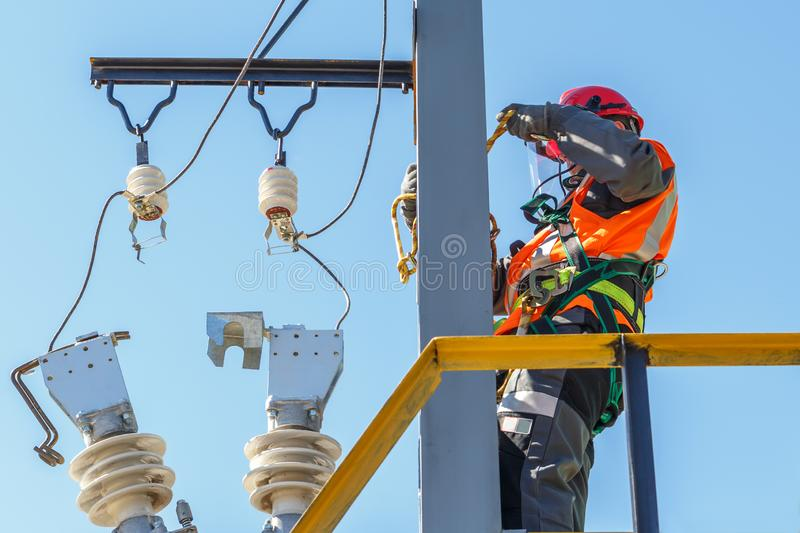 Working electrician working with electrical equipment royalty free stock photo