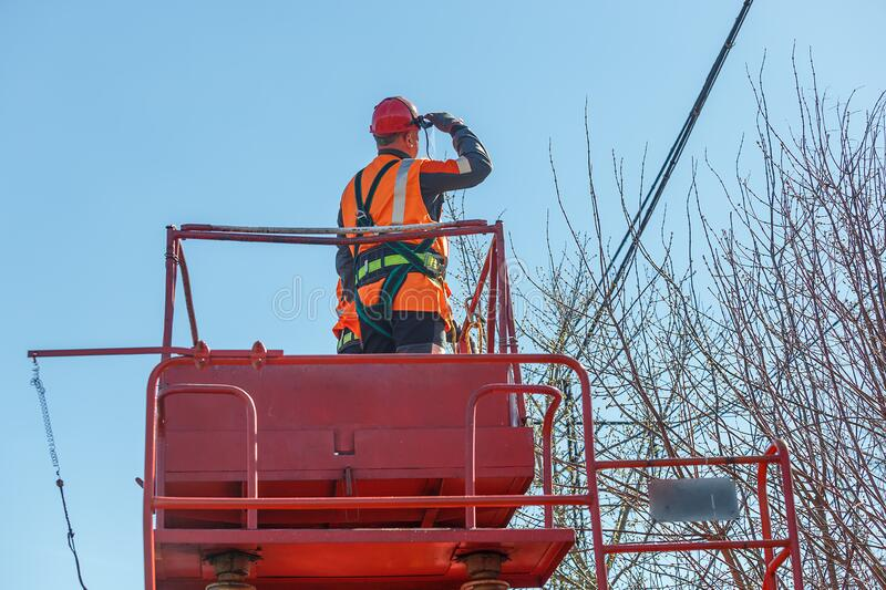 Working electrician looks at the power lines royalty free stock photos