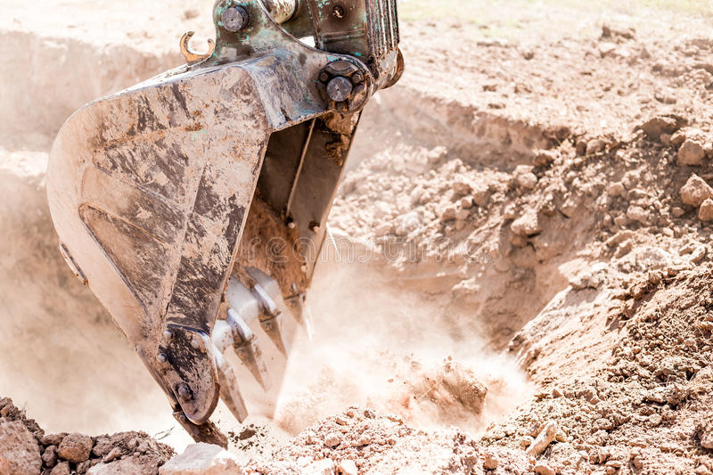 Working Excavator Tractor Digging A Trench. Excavator Tractor Digging A Trench on site stock photography