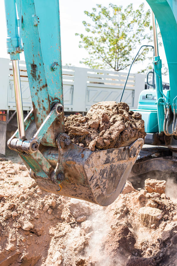 Working Excavator Tractor Digging A Trench. Excavator Tractor Digging A Trench on site royalty free stock photo