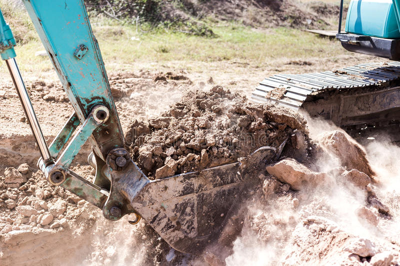 Working Excavator Tractor Digging A Trench. Excavator Tractor Digging A Trench on site royalty free stock photography