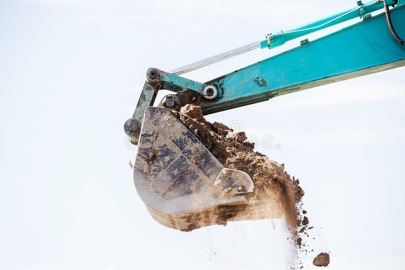 Working Excavator Tractor Digging A Trench. Excavator Tractor Digging A Trench on site stock photo