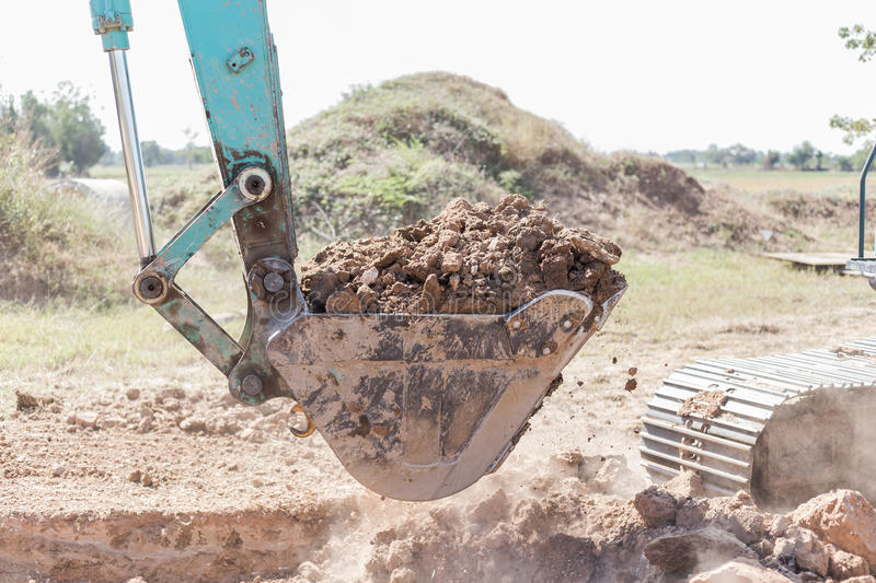Working Excavator Tractor Digging A Trench. Excavator Tractor Digging A Trench on site stock photos