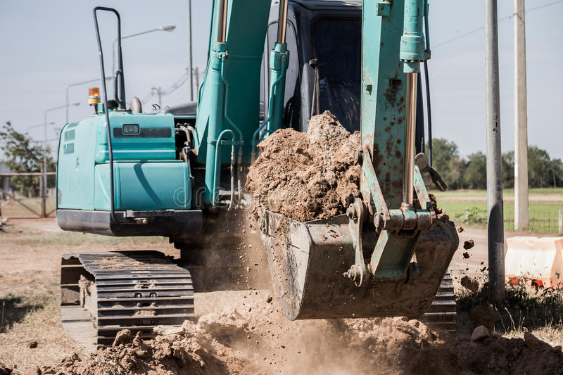 Working Excavator Tractor Digging A Trench. Excavator Tractor Digging A Trench on site stock images