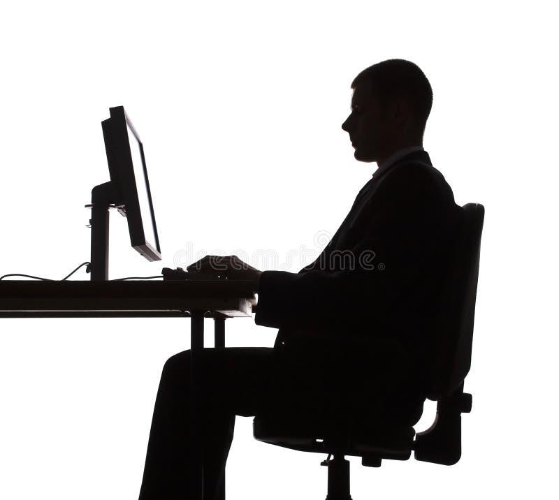 working för silhouette för datorman arkivfoto