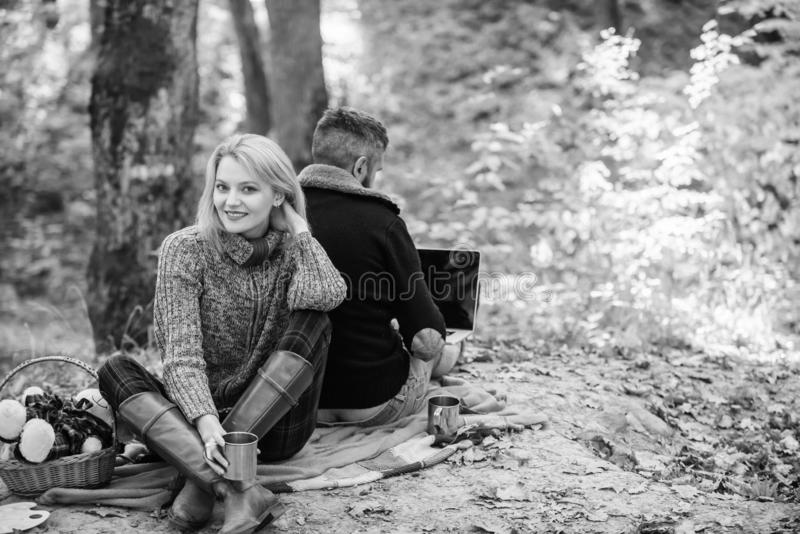 Working on fresh air. Surfing internet. Happy loving couple relaxing in park with laptop. Always at work. Man freelance royalty free stock photos