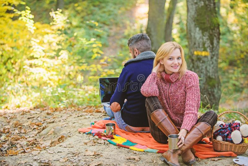 Working on fresh air. Surfing internet. Happy loving couple relaxing in park with laptop. Always at work. Man freelance. Worker internet addicted gamer with royalty free stock photos