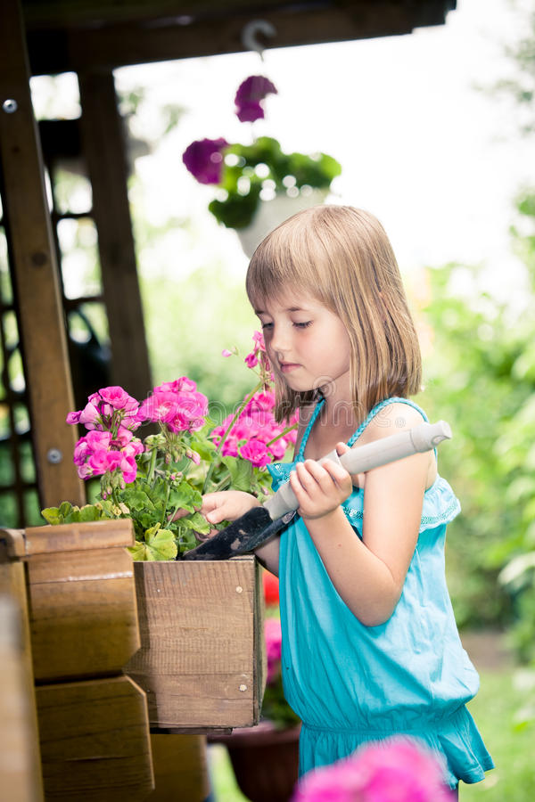 Download Working in the garden stock photo. Image of girl, little - 26480796