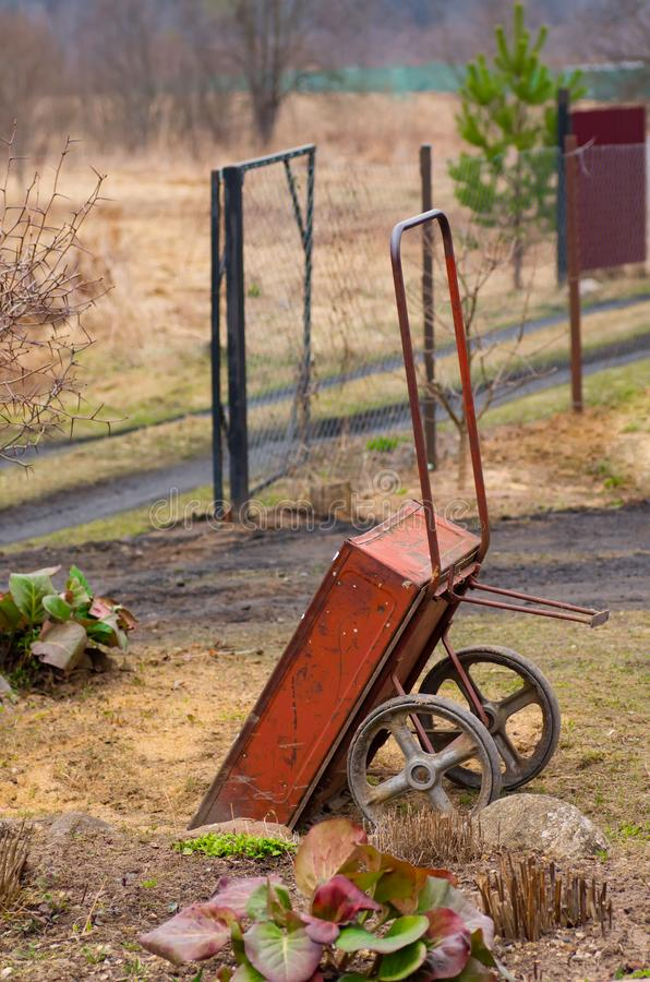 Trolley for garden work/ Garden tools. Wheelbarrow for garden work stock image