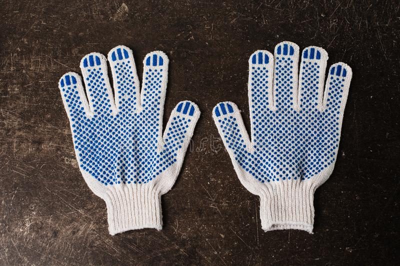 Working gloves on a dark marble background. Tidy up the house. Do makeovers stock images
