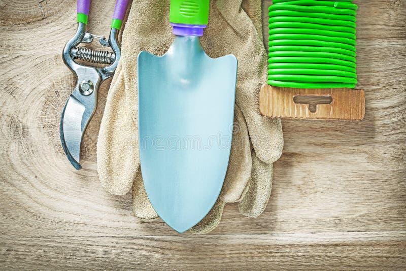 Working gloves secateurs hand spade garden soft tie on wooden bo. Ard gardening concept stock image
